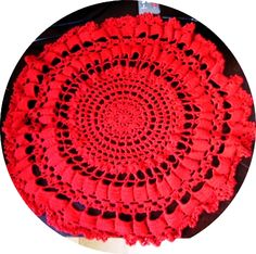 round red cotton table doily, handmade with dark red crochet cotton, delicate pattern. ideal for centre of table.    size 50 cm across postage included    This product is made by Northern Thailand Single women, who make small objects to support their children. I am helping by selling their produc...