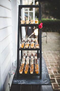 Shelf of individual sweets in a cute chalkboard display #wedding #weddingdessert #diywedding #desserttable #rusticchic