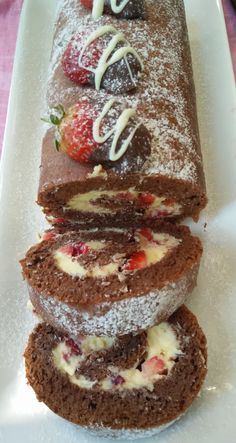 Mascarpone and Strawberry filled Chocolate Swiss Roll makes a decadent and stunning dessert. Creamy mascapone and strawberries are spread on a soft sponge.