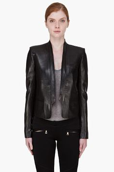 My go-to ensemble for any office party is a chic, flowy, luxurious pant with a tuxedo-style jacket and a nice silk shirt, or a tailored and narrow tuxedo-style trouser, topped with a gorgeous silk shirt, and finished with a glamorously understated jacket.    BALMAIN Black Leather Blazer