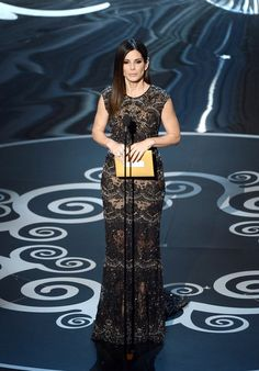 Sandra Bullock Sparkles in Silver at the 2013 Oscars: Sandra Bullock on stage at the 2013 Oscars.