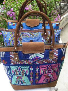 Beautiful shoulder bag made from a Guatemalan authentic vintage ''Chajul'' huipil textile and finished with genuine chocolate suede leather.