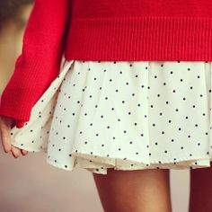 Red sweater and polka dot skirt. Discounts on fun fashions like these at Studentrate.com