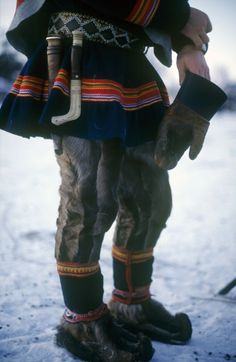 "Gakti are the traditional Sami costumes. Men's gákti have a shorter ""jacket-skirt"" than a women's long dress."
