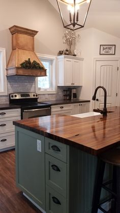 My farmhouse kitchen. The heart of our home. Every part of this space was a DIY project. DIY Concrete counter tops, DIY custom range hood, DIY black walnut butcher block island. Even the cabinets were maple trees that we cut, planed, ripped, glued, trimmed and sanded. Love this space and everything it means to the family!