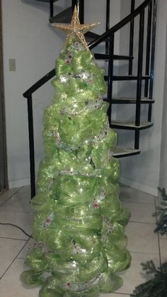 "Christmas Tree made from Deco-Mesh Ribbon, 4"" zip ties and a tomato cage.  Options are endless!"