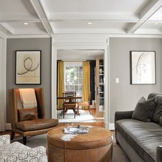 Love the grey sofa with tan leather chair and a lighter grey on walls.