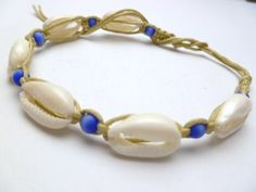 """NATURAL COWRY SHELL ANKLET / BRACELET WITH BLUE BEADS East of Maui Hawaiian Store. $5.99. Unisex for male or female. * Fits 7-9"""" length should fit most as a bracelet & some women as an anklet.. A surfer style look with woven hemp with seven real cowry shells with blue beads between each shell and a ball & loop fastener.. Designed in Hawaii & made in the Philippines."""