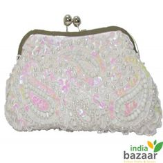 White colour and kiss closure, this glitzy and glamorous clutch bag is definitely going to make you excited like never before. It's a piece of accessory that caters to the desire of every woman, elegant and charming enough to impress with the very first glance. Opulently crafted with premium beads and threads it's a must have home delivery shopping item for every chicy woman.
