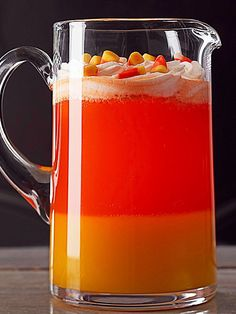 Candy Corn Drink Halloween Drink    Sweet! Half the fun of this kid-friendly party drink is how cool it looks served in clear glass. The other half of the fun? The citrusy flavor combination is a thirst-quenching  party pleaser. Layers of mango-sweetened gelatin, bubble-filled orange drink, and honey-infused whipped cream imitate the classic Halloween candy treat.