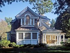 I'm in love with the white trim and big porch.