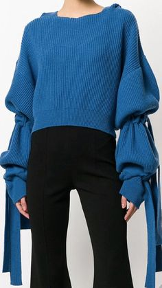 Oversized bell sleeves with ties -- designer unknown
