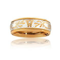 Cellini Jewelers Truffle' Ring by Wellendorff  'Truffle' spinning band ring, in off-white cold enamel and golden vine design. Handcrafted in 18-karat yellow gold.