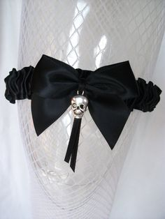 Hey, I found this really awesome Etsy listing at https://www.etsy.com/listing/164720243/halloween-garter-with-skull-charm-choice