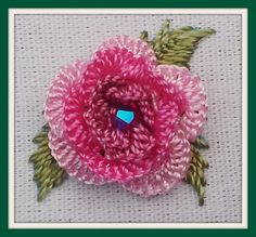 """Canada's Rose: basically 3 rounds with 1st round of stitches through fabric only --5 running cast-on stitches for each round. This version has 15, 15 and 18, changing the color each time around. I added a 4mm Swarovski bicone crystal (the AB finish adds the extra sparkle; the color is named """"Siam"""""""