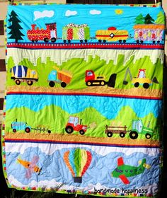 Amazing quilt for little boy  for Tigger's third birthday with train, construction vehicles, tractors and planes. Full of vibrant colours.