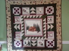 Quilt I made for my son-in-law from Vermont. I started with a panel for the center and built the quilt around it.