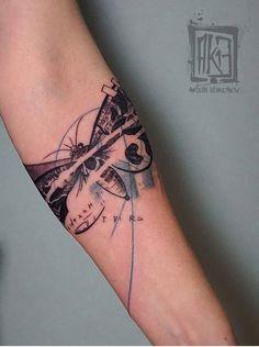 Artem Korobov moth tattoo
