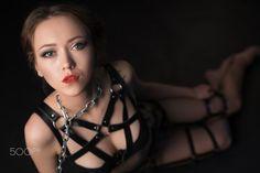 BDSM. Studio photo of beautiful girl on leash - BDSM. Studio image of beautiful young woman on leash