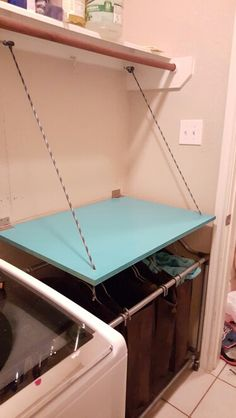 Diy folding top for folding laundry cabinets shorter brook folding table painted with spray paint used hooks hinges and rope to be about to fold upward if necessary for space solutioingenieria Images