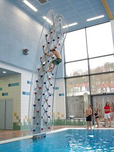 poolside rock climbing wall is a must have. Turn your backyard pool into the next obstacle course from American Gladiator with the… Climbing Wall, Rock Climbing, Future House, My House, Swimming Pool Toys, Diving Board, My Pool, Pool Fun, Rock Wall