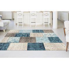 Impart an artisan touch to your home with the look of handmade luxury in this patchwork area rug. The impression of hand-stitching reinforces this boho chic style that has hemmed short edges.