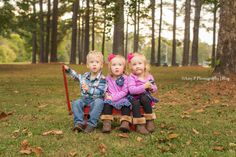 Triplets at Black Creek Park for their outdoor family photo session! This red wagon was so much fun to play with during their photo shoot!