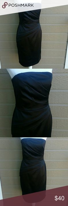 WHBM LBD strapless formal black dress 8 White House Black Market little black dress. Strapless formal black dress. The dress has places for straps to be attached but it does not include straps. Closes in the back with a hook and eye and zipper. The dress is a size 8 and a little loose on the mannequin. In excellent condition.   Bundle for a discount or make an offer! White House Black Market Dresses Strapless
