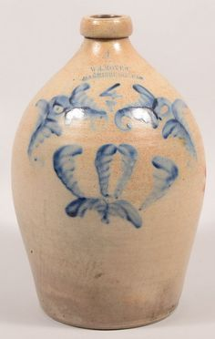 "Sold $ 500 Wm. Moyer, Harrisburg, PA Foliate Decorated 4 Gallon Stoneware Jug. Circa. 1858-1860. Cobalt blue slip decoration ""4"" surrounded by floral and foliate motifs. Ovoid form with molded spout and loop handle. 16"" high. Condition: Good, spout professionally restored."