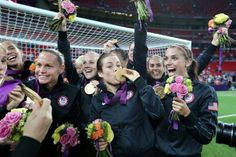 The United States women's soccer team celebrates with the gold medal Thursday.