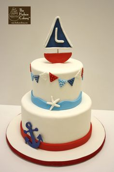 red, blue, white sailboat anchor nautical birthday cake