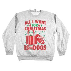 """Say hello to the adorable pup sneaking out of a gift box on our sweet """"All I Want for Christmas is All the Dogs"""" apparel. Makes the paw-fect paw-liday gift. www.animalhearted.com"""