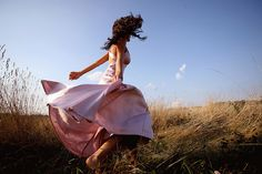 Wind swept flowing gown, adds grace to the already graceful.