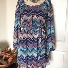 """BOGO SALE Speechles Flowy Dress Scoop Neck Chevron print dress.   Beautiful turquoise, plum, and cream colors.  Dress has a cinched elastic waist, sheer sleeves and is fully lined. (Minus sleeves) light flowy material. Removable waist tie ribbon.  Perfect condition- Very cute and flattering style   Measures 33"""" in length Speechless Dresses"""