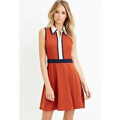 STYLE  Forever 21 Contemporary   A sleeves fit and flare dress with colorblocked detailing a basic collar and a partially zippered front.Woven unlined.  100% p…