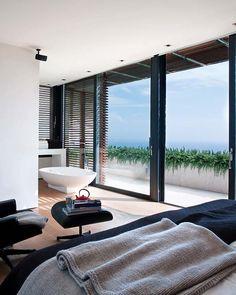 bedroom with fabulous view + bathtub
