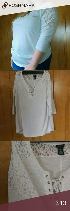 Torrid 3/4 lace sleeves high low shirt Torrid shirt with 3/4 lace sleeves and a tie detail in front cream-colored high low. Tops
