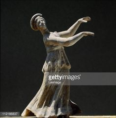 Fine art : Greek Art. Dancer. Terracotta from Tanagra (Greece), 5th century BC. Museo Archeologico Nazionale, Taranto, Italy