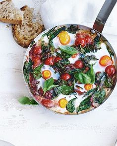 Baked eggs aren't just for brunch. This Mediterranean-style recipe cooks eggs in spicy tomato sauce with courgettes and spinach to make a healthy, one-pot dinner.