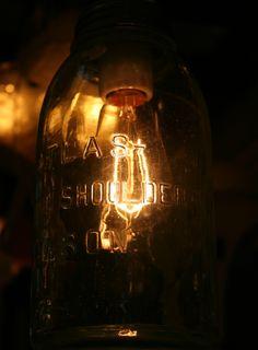 Antique glass jar repurposed as a light.