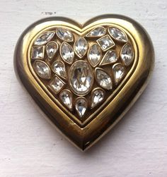 Love this vintage Yves Saint Laurent Rhinestone and Gold Compact. Just $40.00 via Etsy.