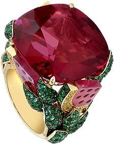 "This colourful Piaget ring is inspired by the ""Watermelon Dream"" cocktail. The watermelon juice is a rubellite, while the fresh mint leaves are emeralds studded with diamonds.""Limelight cocktail inspiration ring in 18K yellow gold nd black onyx, set with one cushion-cut rubellite (approx. 37 ct), brilliant-cut emeralds and brilliant-cut diamonds."