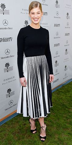 ROSAMUND PIKE We're not sure which we want to add to our wardrobe more Rosamund's long-sleeve Proenza Schouler dress (that pleated skirt!) or her ankle-tie Brian Atwood pumps. Okay, fine, we'll just steal the entire look she wore to the Variety Creative Impact Awards in Palm Springs.