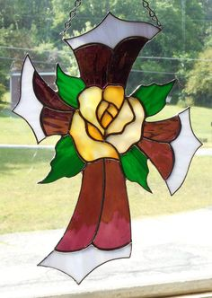 Stained Glass Cross with Rose Center by CandJMountainGlass on Etsy. This one is reserved but you can order one!