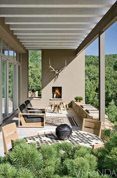 Santa Fe, New Mexico. Architect James Rimelspach draws inspiration from the surrounding landscape to bring this loggia to life.