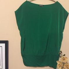 Express top Everyone needs something in their closet this color.  Beautiful kelly green.  In great condition.  Bundle for best deals. Express Tops Blouses