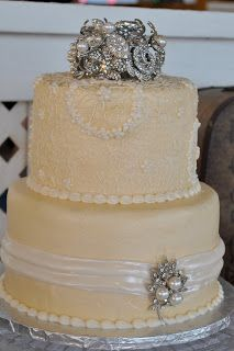 Wedding cake by Cake Junkie in Bryan, Texas. Antique broach bouquet as topper.