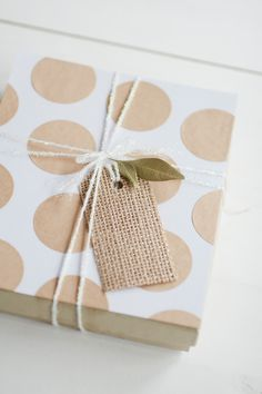 gift wrap: burlap tag and kraft polka dots // #anastasiamariecards