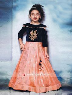 Adorable Peach And Navy Blue Color Paper Silk Hand Work Party Wear Lehenga Choli Gorgeously mesmerizing is what your little angel will look at the next wedding gala wearing this beautiful peach and navy blue color lehenga choli. Let her team this set with Baby Lehenga, Kids Lehenga Choli, Party Wear Lehenga, Silk Lehenga, Choli Dress, Kids Blouse Designs, Choli Designs, Kids Party Wear Dresses, Dresses Kids Girl