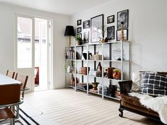 Home with character - via Coco Lapine Design   Frames above a shelf